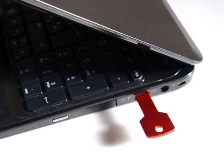 input device: red usb key on black keyboard Stock Photo