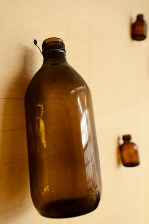 brown bottles: brown bottles hanging on wooden wall - eco concept
