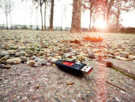 data loss: data loss, data breach - concept usb key dropped