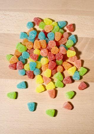gummy bear: Gummy Bear Candy Colorful Background on wood