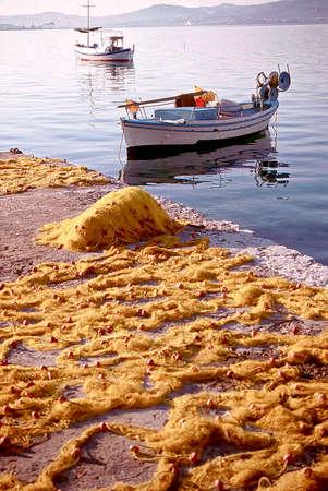 moored: retro fishing boat moored in santorini