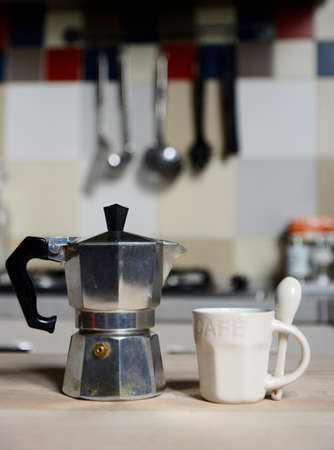 coffeepot: red coffee cup and  vintage coffeepot on kitchen stove