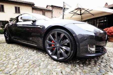 old farm: MILAN , ITALY - APRIL  21 2016 : tesla model S car parked in old farm courtyard in Milan,Italy Editorial
