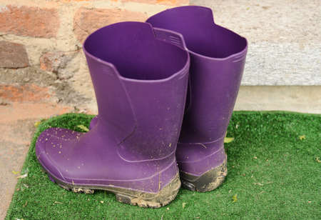 rubber boots: modern muddy rubber boots
