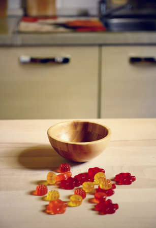colorful Gummy Bear Candy on wooden table on kitchen  background