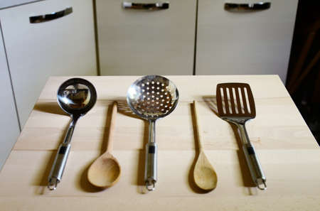 ladles: ladles on wooden table on kitchen  background Stock Photo