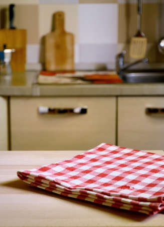 checkered tablecloth: checkered tablecloth on wooden table on kitchen  background
