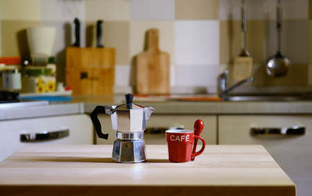 coffee pot: coffee pot on wooden table on kitchen  background