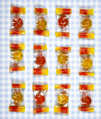 checkered background: colorful Gummy Bear Candy  on checkered background Stock Photo
