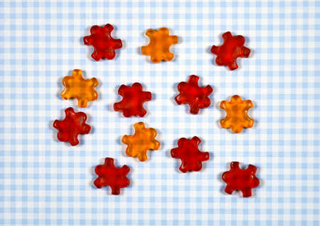 colorful Gummy Bear Candy  on checkered background Stock Photo