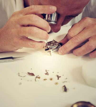 watchmaker: watchmaker making luxury handmade watch