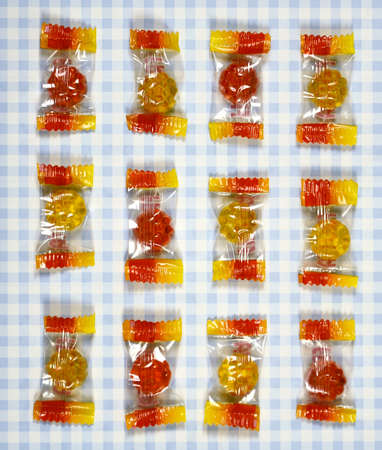 gummy bear: colorful Gummy Bear Candy  on checkered background Stock Photo