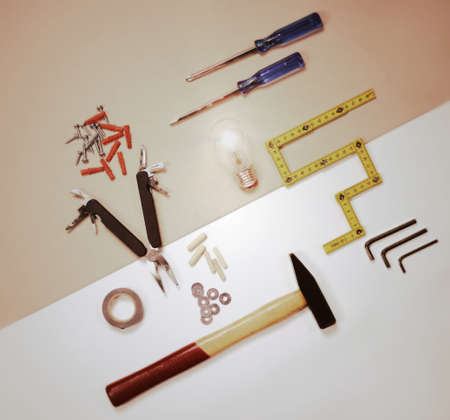 flat lay - working tools and light bulb - solution concept Reklamní fotografie