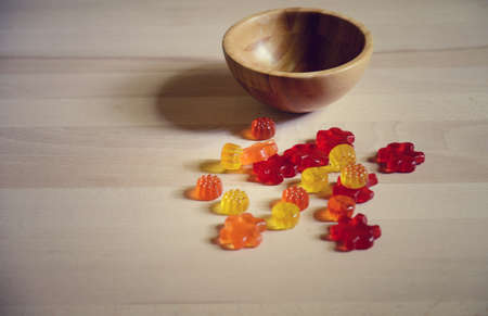 gummy bear: colorful Gummy Bear Candy on wooden table on kitchen  background