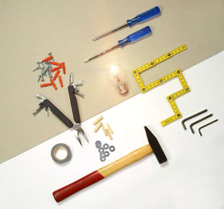 flat lay - working tools and light bulb - solution concept
