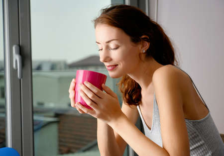 beautiful young woman with pink cup