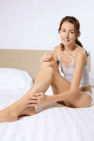 girl  care: woman legs care  in the bed Stock Photo