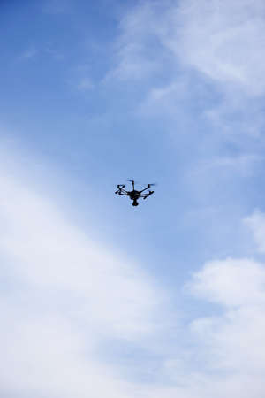 aerospace industry: drone on sky and clouds background Stock Photo