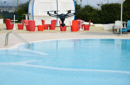 aerospace industry: drone hovering over swimming pool