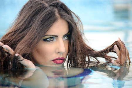 wet lips: portrait of beautiful woman in the water