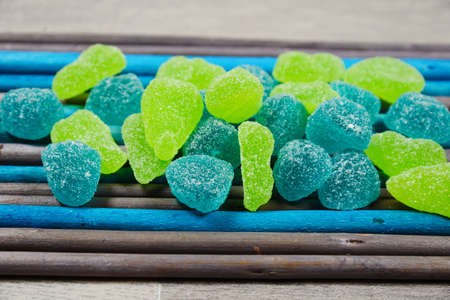 gummy bear: Gummy Bear Candy Colorful Background on colored wooden chopsticks