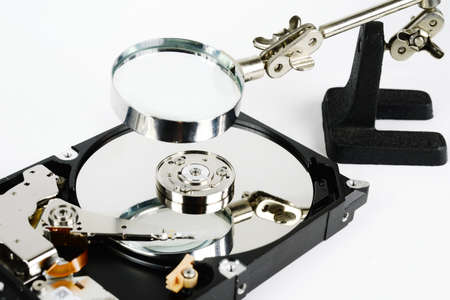 hard disk: closeup - hard disk repair  and magnifying glass Stock Photo