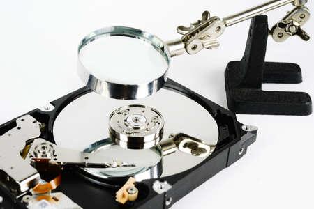 hard disk: closeup - hard disk repair  and magnifying glass Stock Photo