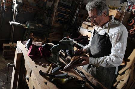 craftsman making luxury handmade man shoes Stock Photo