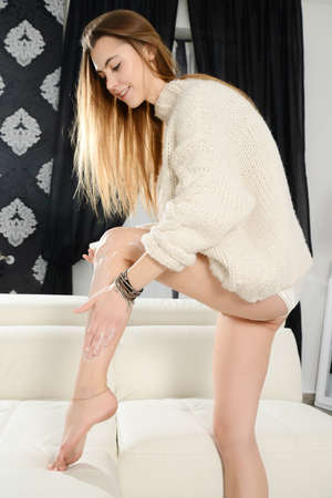 beautiful young woman legs care at home
