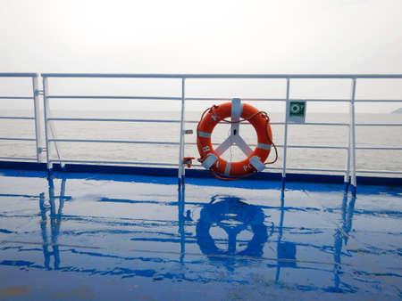 orange ring lifebuoy on ferry boat deck Zdjęcie Seryjne - 101026567