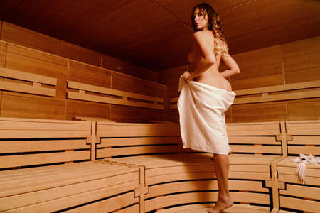 beautiful naked woman relax taking sauna in spa