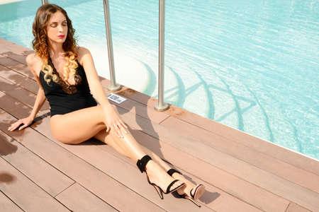 beautiful woman in fashiom swimsuit relax  near  spa pool