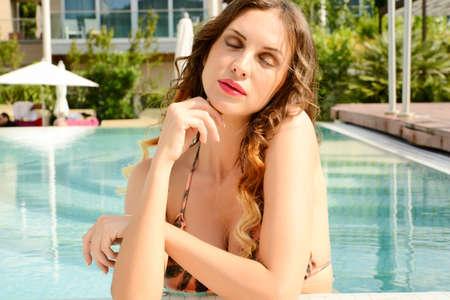 beautiful woman portrait  in fashiom swimsuit relax  near  spa pool