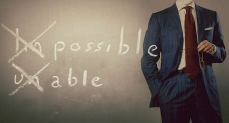 positive thinking concept handwritten on black chalkboard with businessman Reklamní fotografie