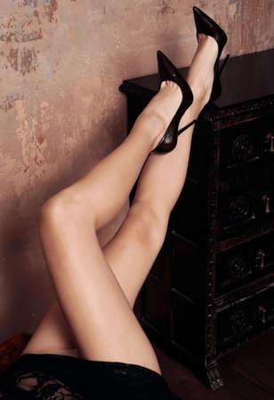sensual woman legs in sexy black dress Stock Photo