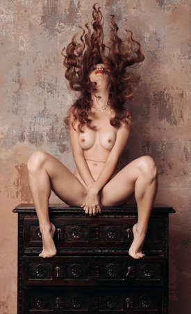 sensual woman withsexy body sitting - artistic nude