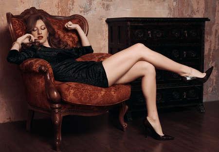 sensual woman in sexy black dress