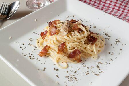 Spaghetti Carbonara on white dish photo
