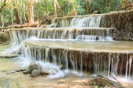Waterfall in deep tropical Forest   in summer , Huay Mae Kamin Waterfall Karnjanaburi Thailand