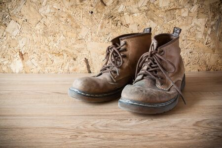 muddy clothes: old leather boot traditional leather style in vintage style
