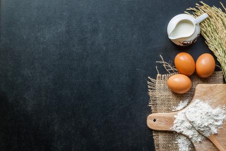 baking powder: Baking powder milk and eggs on chalkboard for background