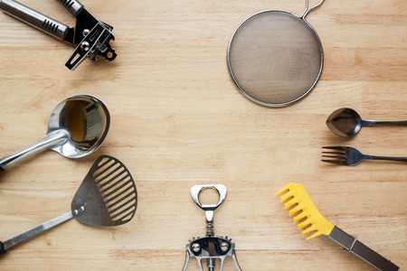 Stainless Steel kitchenware on wooden table for background