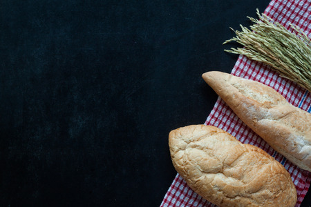 Bread , wheat on black chalkboard , bakery background with free text space