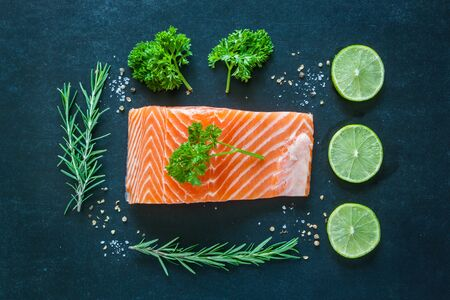 rosmarin: Salmon fillet with garnish on blackboard Stock Photo