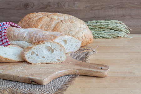 bread on wooden cutting board for bakery background