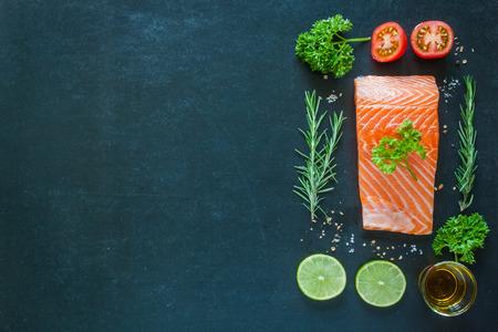 garnish: Salmon fillet with garnish on blackboard Stock Photo