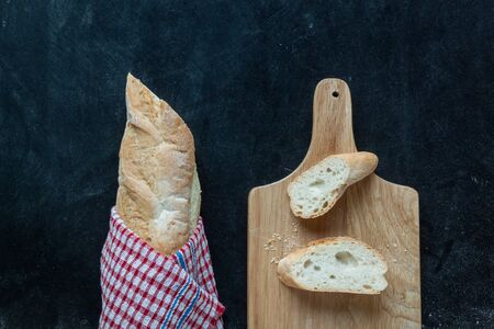 bread and wooden Cutting Board on chalkboard for bekery background