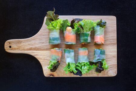 Salad row with The dough sheet on wood cutting board Zdjęcie Seryjne