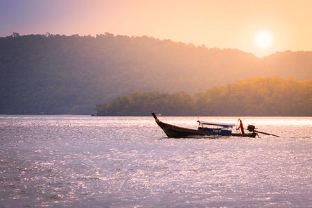 Fishing boat cruising  on the sea at sunrise time