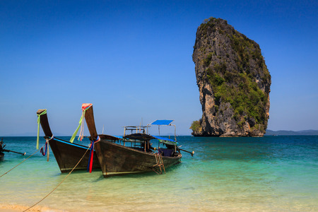 aonang: Long tail boat on the beautiful beach and beauty blue sky , poda island , krabi, Thailand Stock Photo